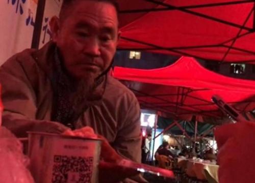 Ăn mày Trung Quốc dùng cả... ví điện tử để xin tiền